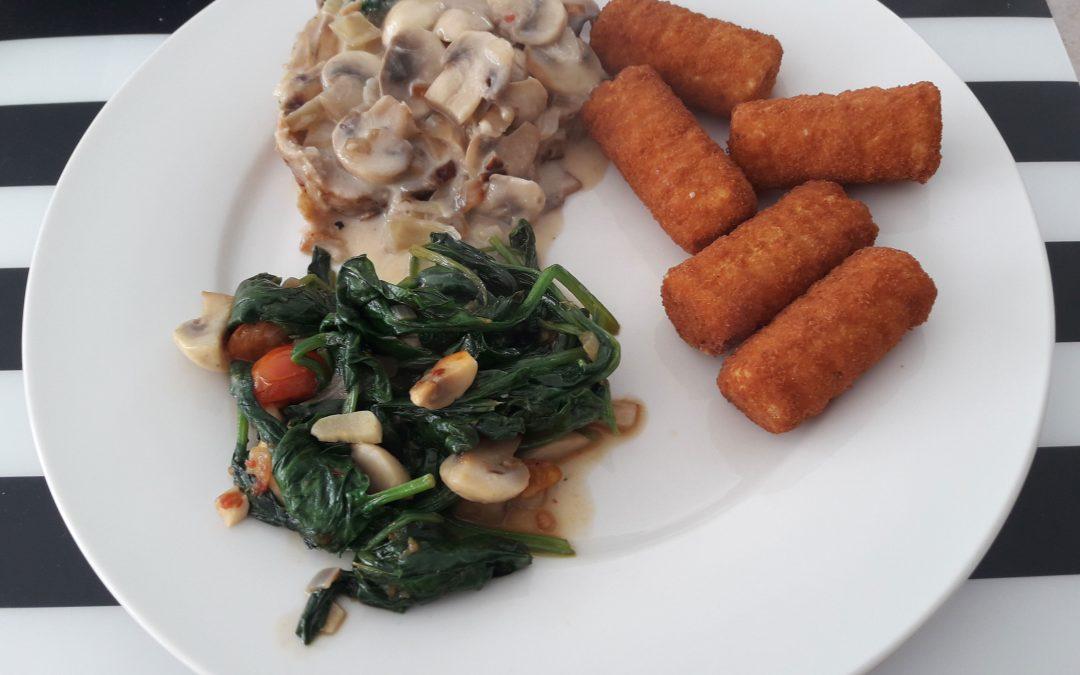 Vleesbrood met spinazie en champignonroomsaus